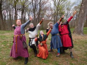 Posing with friends at an archery event in Atlantia,